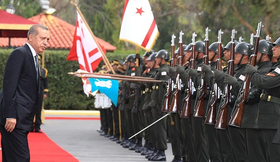 Turkey's President Tayyip Erdogan inspects the honour guard during a visit to Northern Cyprus