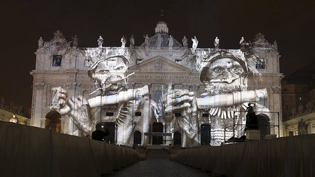 """A picture of corals, part of an art projection featuring images of humanity and climate change artistically rendered by Obscura Digital, is projected onto the faВЌcade of St. Peter's Basilica, as part of an installation entitled """"Fiat Lux: Illuminating our Common Home"""" as a gift to Pope Francis on the opening day of the Extraordinary Jubilee, at the Vatican, December 8, 2015.  REUTERS/Stefano Rellandini FOR EDITORIAL USE ONLY. NO RESALES. NO ARCHIVE."""